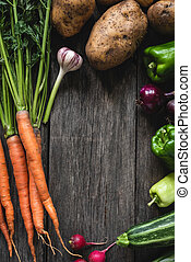 Vegetables harvest on wood background. Fresh organic vegetables