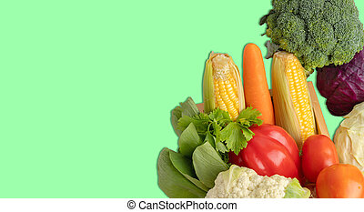 Vegetables heap on the green background