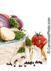 Vegetables in a basket isolated on white