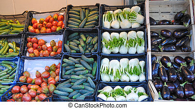 Vegetables in crate on a market shelf