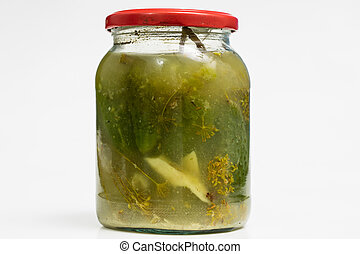 Vegetables in jars prepared for the winter. Tasty preserves on a white kitchen table.