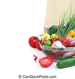 vegetables in metal colander over white (with sample text)