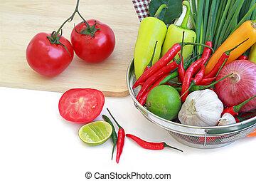 vegetables in metal colander