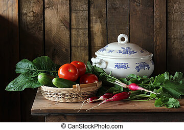 Vegetables in the basket. Still life with fresh vegetables.