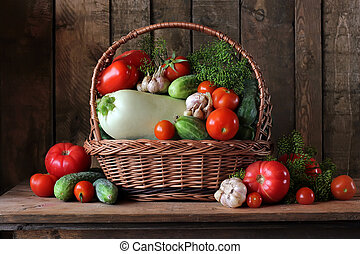 Vegetables in the basket. Still life with tomatoes and cucumbers.