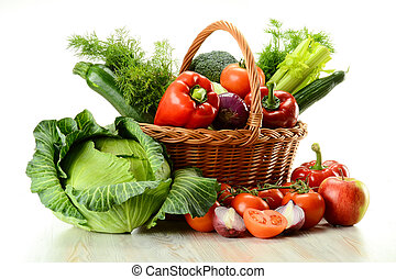 Vegetables in wicker basket - Composition with raw ...