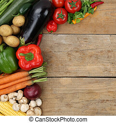 Vegetables like paprika and tomatoes on wooden board with copysp