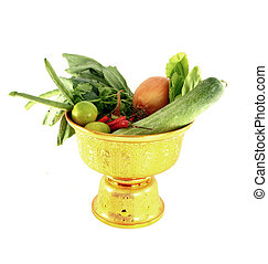 Vegetables mix on golden tray on white background