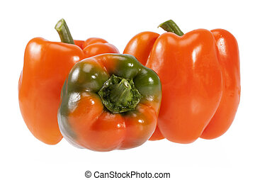 Vegetables of orange and green pepper isolated on white background.