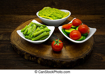 Vegetables on a dark wooden background