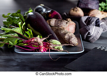 Vegetables on a plate with notebook