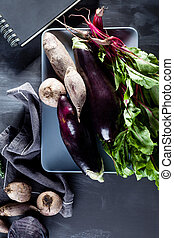 Vegetables on a plate with notebook from the top