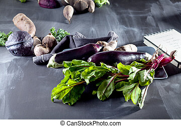 Vegetables on a plate with open notebook