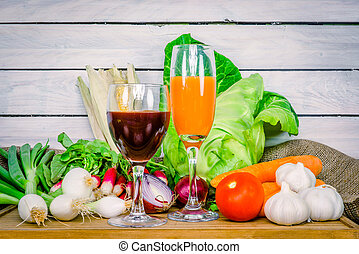 Vegetables on a wooden table with juice