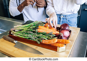 vegetables on a wooden tray in the kitchen