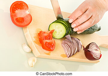 Vegetables on chopping board - Woman cutting vegetables on ...