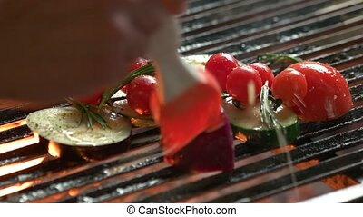 Vegetables on grill close up. Eggplant, cherry tomatoes and...