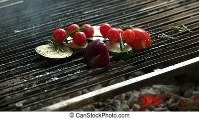 Vegetables on grill. Zucchini, cherry tomatoes and onion.