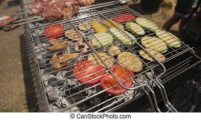 Vegetables on the grille and shish kebab on skewers are...