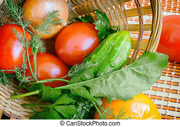Vegetables on the table in a wicker basket.