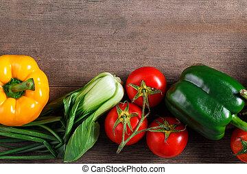 Vegetables on wood background. Organic food.