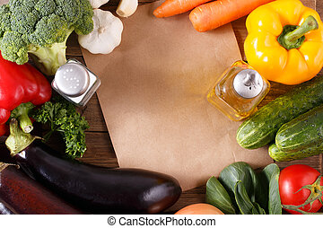 Vegetables on wood background with space for recipe.