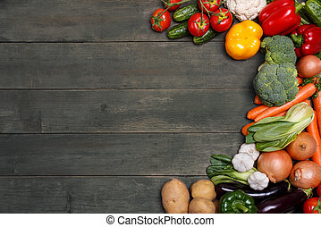 Vegetables on wood background with space for text. Organic food.