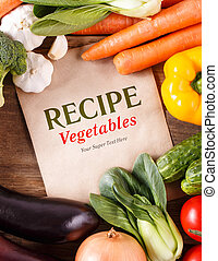 Vegetables on wood background with space for recipe. Organic foo