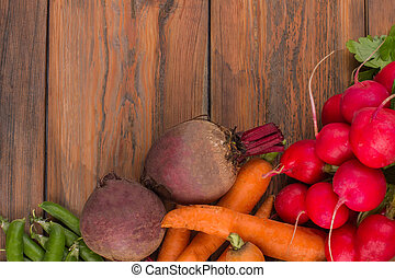 Vegetables on wood with copyspace.
