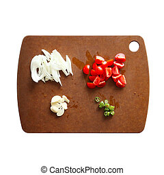 Vegetables on wooden cutting board