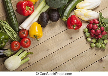 Vegetables on wooden surface - Variety of vegetables on ...