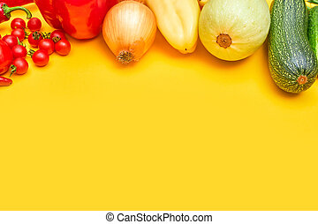 vegetables on yellow background, copy space one
