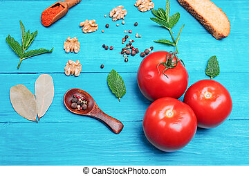 vegetables, pepper, nuts on a wooden table