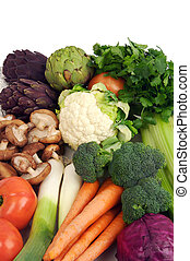 raw vegetables consisting of carrots, leeks, brocolli, shitake mushrooms, cilantro, tomatoes, califlower, purple and green arichokes and celery