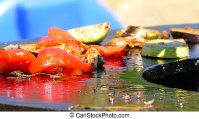 Vegetables secrete juice and fry on fire - appetizing...