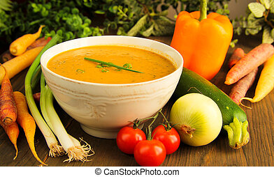 Vegetables soup with fresh surround by fresh vegetables