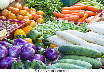 Vegetables Stand in Wet Market in Asia with Cucumbers Tomatoes Carrots Beans Eggplant Radish