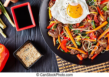 vegetables stir fried, noodles and beef, top view