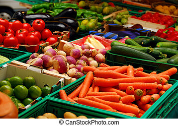 Vegetables - Fresh assorted vegetables in boxes on...