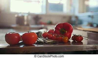 Vegetables, tomatoes, paprika, leeks lying on the table in...