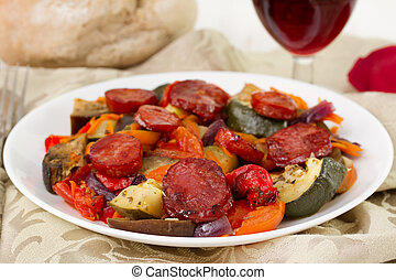 vegetables with chorizo on the white plate
