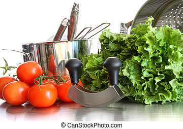 Vegetables with kitchen pots and utensils on white...