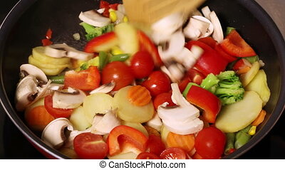 Vegetables with mushrooms fried in a pan - Vegetables with...
