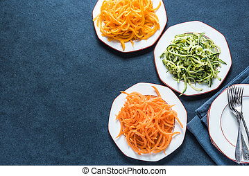 Vegetarian and healthy spaghetti, lay flat on table from ...