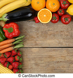 Vegetarian and vegan fruits and vegetables on wooden board with