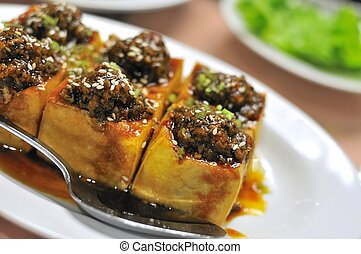 Chinese vegetarian bean curd cuisine with mock meat toppings. For food and beverage, and healthy lifestyle concepts.