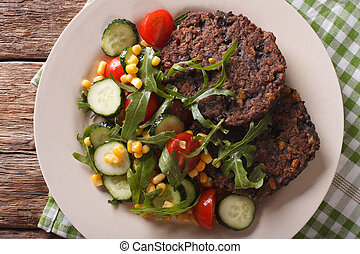 Vegetarian black bean burgers and fresh vegetable salad...