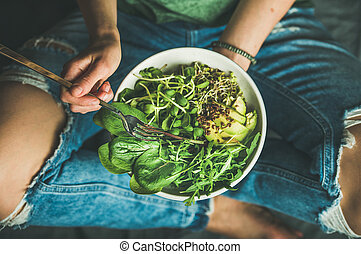 Vegetarian breakfast with spinach, arugula, avocado, seeds and sprouts