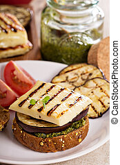 Vegetarian burger with cheese, eggplant and pesto