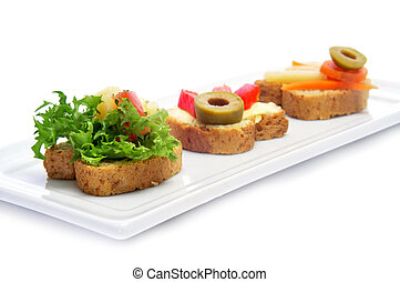 vegetarian canapes - closeup of a plate with different...